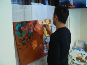 Tibor Balogh painting a canvas while being inspired by the discussion on restorative justice